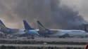 De la fumée sort de l'aéroport de Karachi le 9 juin 2014.