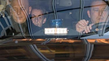 Nicolas Sarkozy arrive au pôle financier du palais de justice de Paris pour une audition avec un juge dans le dossier des frais de campagne.
