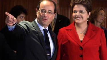 La présidente brésilienne Dilma Rousseff a accueilli mercredi sous un ciel pluvieux la centaine de chefs d'Etat et de gouvernement, dont François Hollande, venus participer au sommet de Rio+20, alors que le projet de déclaration finale suscite déjà des cr