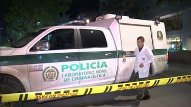 Un membre de la police scientifique de Bogota près de la scène de crime où un ingénieur de Thales a été abattu, à Bogota, le 2 décembre 2019