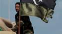 Insurgés à Benghazi, dans l'est de la Libye. La France a apporté son soutien au Conseil national créé par l'opposition libyenne, qui tente de renverser Mouammar Kadhafi. /Photo prise le 6 mars 2011/REUTERS/Suhaib Salem