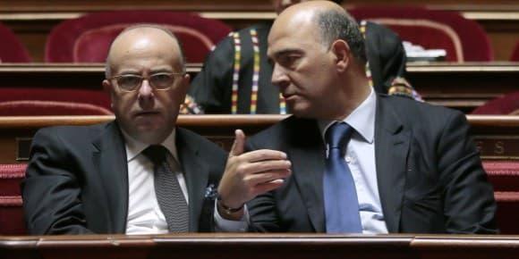Bernard Cazeneuve et Pierre Moscovici à l'Assemblée.