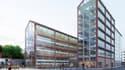 Le bâtiment est articulé en un socle avec 2 ailes de hauteur différentes respectant celle des bâtiments voisins.