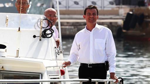 En 2013, Manuel Valls à Antibes avec Eric Ciotti, sur une vedette de la police.