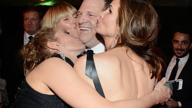 Harvey Weinstein entouré de Heidi Klum, Uma Thurman  en 2014.