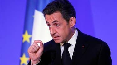"""Nicolas Sarkozy lors du discours d'inauguration du nouveau siège de l'Organisation internationale de la Francophonie. Le chef de l'Etat a prôné vendredi une révision des """"traditions"""" de la diplomatie française, au lendemain du vote à l'Onu d'une résolutio"""