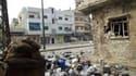 """Dans une rue de Homs. A l'occasion d'une réunion des """"Amis de la Syrie"""", à Tunis, la Ligue arabe a réclamé l'adoption d'une résolution du Conseil de sécurité de l'Onu appelant à un cessez-le-feu en Syrie, tandis que le Qatar a plaidé pour la constitution"""