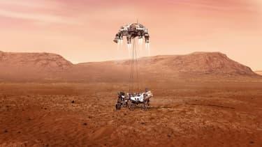 Illustration fournie par la Nasa du rover Perseverance au moment de son atterrissage sur Mars, après avoir descendu les derniers mètres le séparant du sol le long de câbles suspendus depuis l'étage de descente