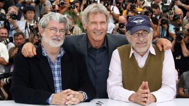 """George Lucas, Harrison Ford et Steven Spielberg lors de la présentation de """"Indiana Jones et le Royaume du Crâne de Cristal"""" à Cannes en 2008."""
