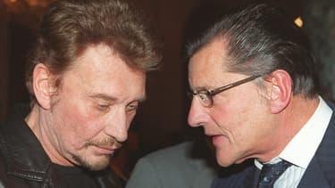 Johnny Hallyday et son producteur Jean-Claude Camus, à l'Elysée le 16 novembre 1999.