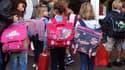 Douze millions d'élèves ont repris lundi matin les cours lors d'une rentrée marquée par l'entrée en vigueur de la réforme du lycée et 16.000 suppressions de postes sur le budget 2011. /Photo prise le 5 septembre 2011/REUTERS/Charles Platiau