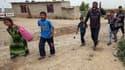 Des civils fuyant Mossoul, le 5 mai 2017