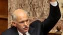Le Premier ministre grec George Papandreou. Le parlement grec a donné jeudi son feu vert définitif à un nouveau plan d'austérité du gouvernement socialiste destiné à obtenir une aide internationale. /Photo prise le 20 octobre 2011/REUTERS/Costas Baltas/Ic