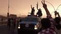 Capture d'écran d'une vidéo mise en ligne en juin 2014 montrant des combattants de l'Etat islamique en parade à Mossoul, en Irak.