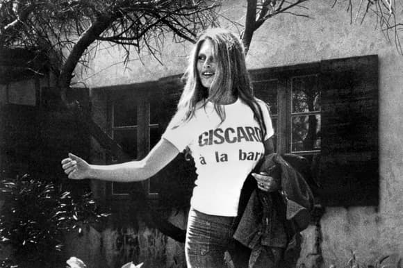 Actress Brigitte Bardot wearing tee-shirt supporting presidential candidate Valéry Giscard d'Estaing. France, 1974 {580x386]
