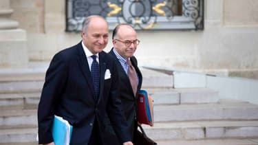 Laurent Fabius, ministre des Affaires étrangères, et Bernard Cazeneuve, ministre du Budget
