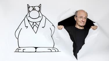"""Philippe Geluck et son """"Chat"""", en septembre 2017 à Paris."""