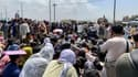 Des Afghans à l'aéroport de Kaboul, attendant de quitter l'Afghanistan le 20 août 2021. (Photo d'illustration)