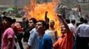 Manifestants place Tahrir, dans le centre du Caire, dimanche. Les partisans de la démocratie en Egypte, qui avaient souhaité la peine de mort pour Hosni Moubarak, ont lancé dimanche un appel à un nouveau soulèvement, au lendemain de la condamnation à la r