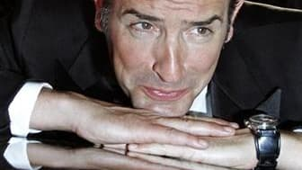 """Jean Dujardin a reçu dimanche le prix d'interprétation masculine du 64e Festival de Cannes pour son rôle dans """"The Artist"""" de Michel Hazanavicius. /Photo prise le 15 mai 2011/REUTERS/Yves Herman"""