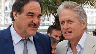 """Présentée vendredi hors compétition à Cannes, la suite de """"Wall Street"""" signe le retour du trader sans scrupules Gordon Gekko, toujours interprété par Michael Douglas (à droite), mais ce film est plus un histoire d'amour qu'une critique de l'argent roi, s"""