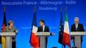 """A l'issue d'un sommet à trois à Strasbourg avec le nouveau président du Conseil italien, Mario Monti, Nicolas Sarkozy a semblé faire un pas vers Angela Merkel, qui est restée intransigeante sur l'indépendance de la BCE. """"Tous les trois, nous avons indiqué"""
