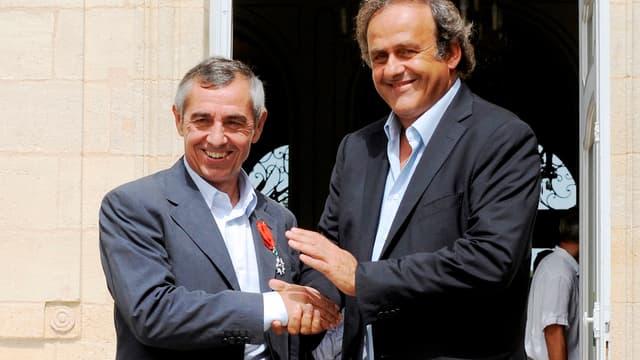 Michel Platini aux côtés d'Alain Giresse, ici en 2012.
