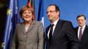 Relancer la croissance en Europe, tel était le thème du dîner qui a réuni lundi à Berlin François Hollande, Angela Merkel, José Manuel Barroso et des chefs d'entreprises invités à réfléchir sur la compétitivité dans l'Union européenne. /Photo prise le 18