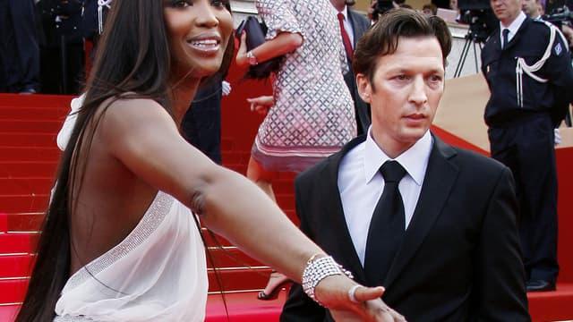 Christophe Rocancourt, ici en 2008 au côté du mannequin Naomi Campbell, est de nouveau au coeur d'une affaire d'escroquerie.