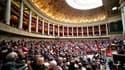 Les députés socialistes devraient, sauf coup de théâtre, joindre leurs voix à celles de l'UMP pour voter le volet français du plan d'aide à la Grèce, même si la gauche aurait préféré des taux moins élevés. /Photo d'archives/REUTERS/Charles Platiau