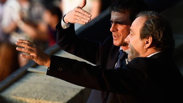 Le Premier ministre Manuel Valls et le patron de l'UEFA Michel Platini, à Berlin pour la finale de la Ligue des Champions le 6 juin 2015.