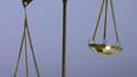 Treize personnes dont sept policiers interpellées dans une affaire de corruption dans l'agglomération lyonnaise mardi ont toutes été mises en examen. /Photo d'archives/REUTERS/Eric Gaillard