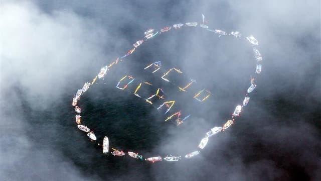 Manifestation de pêcheurs à Homer, en Alaska, pour la protection des océans contre l'acidification. Selon des scientifiques de plusieurs pays, les océans du globe s'acidifient actuellement à un rythme qui est sans doute sans équivalent depuis 300 millions