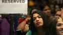 En octobre 2013, des personnes attendent à Bombay, lors d'un séminaire sur les transgenres.