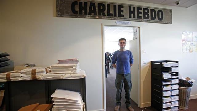 Stéphane Charbonnier, dit Charb, directeur de la publication de Charlie Hebdo. La controverse sur les caricatures du prophète Mahomet publiées par l'hebdomadaire satirique français Charlie Hebdo va passer sur le terrain judiciaire dans un climat de forte