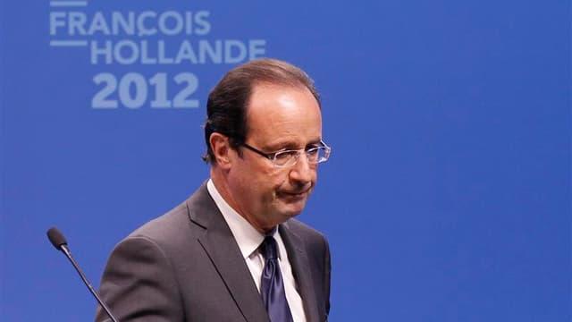 François Hollande a élevé jeudi au rang de priorités la lutte contre le terrorisme, la sécurité et la défense de la laïcité, estimant que ces domaines ne sauraient être l'apanage de la droite. /Photo prise le 22 mars 2012/REUTERS/Benoît Tessier