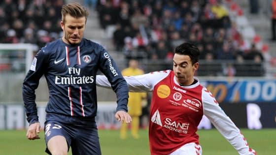 David Beckham et Diego Rigonato à Reims le 2 mars 2013.