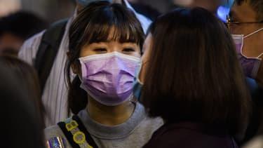 Les habitants de Hong Kong se protègent contre la propagation du coronavirus, le 23 janvier 2020