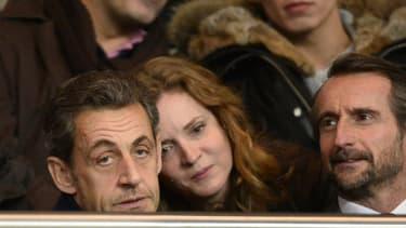 L'ancien président Nicolas Sarkozy à côté de la candidate UMP à la mairie de Paris Nathalie Kosciusko-Morizet au Parc des Princes le 22 décembre 2013.