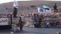 Membres de l'Armée syrienne libre au point de passage vers la Turquie de Binsh, dans le nord de la Syrie. Des opposants à Bachar al Assad ont pris le contrôle d'un troisième point de passage frontalier vers la Turquie, à Tel Abyad, après plusieurs heures