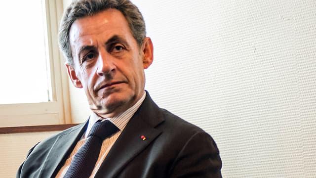 Le président de l'UMP Nicolas Sarkozy, ici à Tourcoing, le 29 janvier, est embarrasé par son rival Alain Juppé.