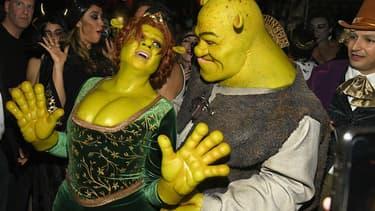Heidi Klum et Tom Kaulitz, déguisés en Fiona et Shrek pour la fête d'Halloween, le 31 octobre 2018.