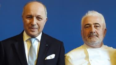 Laurent Fabius et Guy Savoy lors d'une conférence de presse le 21 janvier 2015.