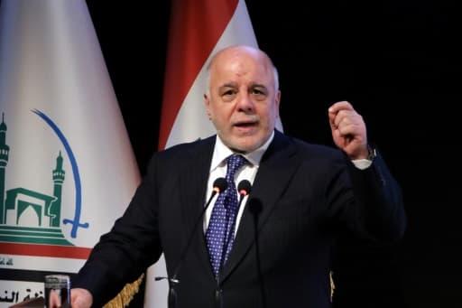 Le Premier ministre irakien Haider al-Abadi s'exprime lors d'une cérémonie dans la ville sainte chiite de Najaf, le 7 janvier 2018