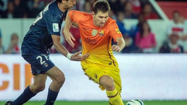Javier Pastore face à Lionel Messi