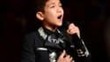 """Sebastien De La Cruz, 11 ans, a interprété en tenue traditionnelle de mariachi le """"Star-Spangled Banner"""" en ouverture du 3e match opposant Miami à l'équipe de San Antonio, Texas."""