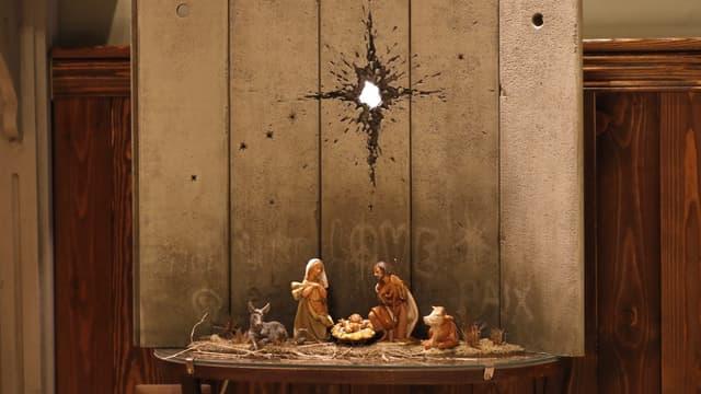 """""""La cicatrice de Bethléem"""", nouvelle oeuvre de Banksy présentée au Walled Off Hotel, le 20 décembre 2019"""