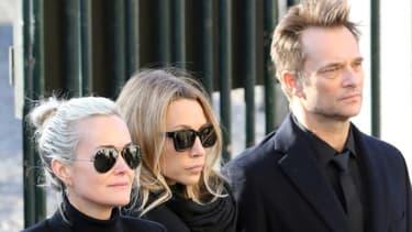 Laeticia Hallyday, Laura Smet et David Hallyday (de G à D) lors des funérailles de Johnny Hallyday à l'église de la Madeleine à Paris le 9 décembre 2017