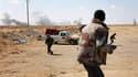 Rebelles à l'entrée de la ville d'Ajdabiah, dans l'est de la Libye. Les rebelles libyens disent avoir repoussé vendredi un assaut de l'armée régulière à Misrata, dans l'Ouest du pays, mais des responsables de l'Otan reconnaissent que leur appui aérien a s