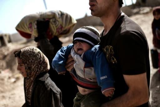 Des familles irakiennes fuient les combats le 28 février 2017 à Mossoul
